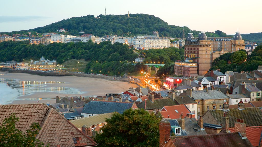 Scarborough featuring a coastal town and a beach