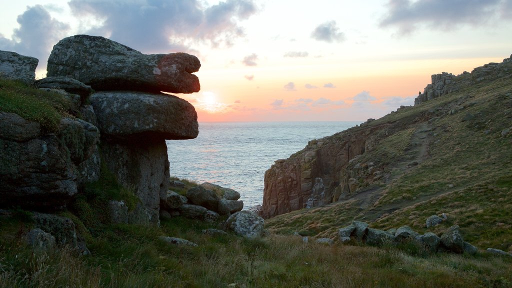 Land\'s End which includes a sunset and rocky coastline