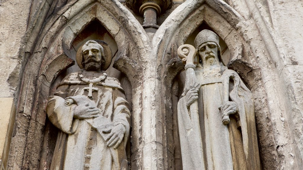 Exeter Cathedral featuring a church or cathedral, religious elements and a statue or sculpture