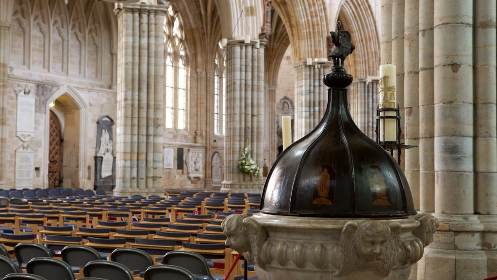 Exeter Cathedral showing interior views, religious aspects and a church or cathedral