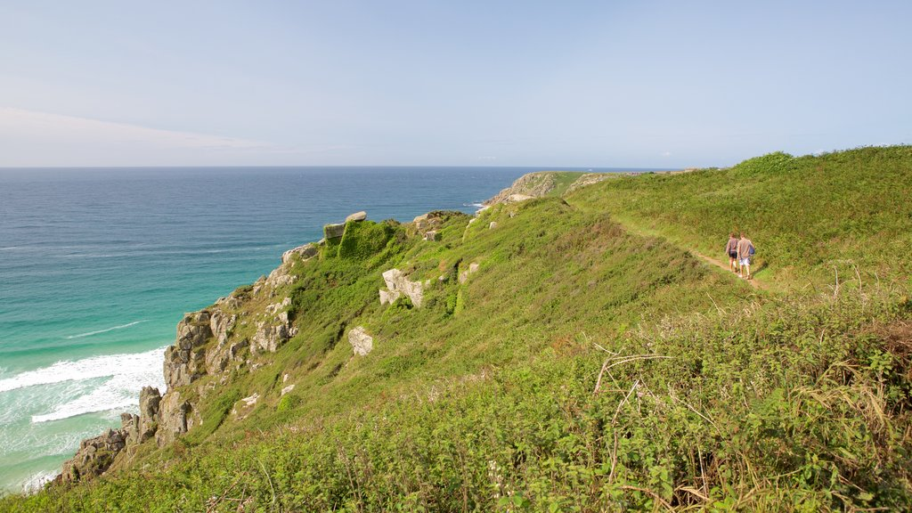 Porthcurno Beach which includes hiking or walking and general coastal views