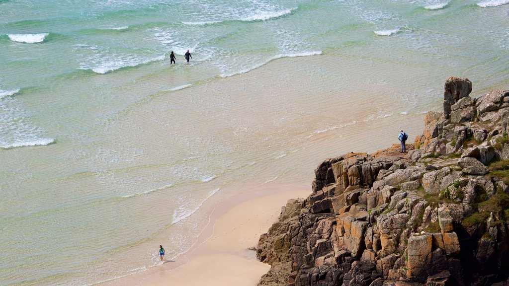 Porthcurno Beach showing rugged coastline and a beach
