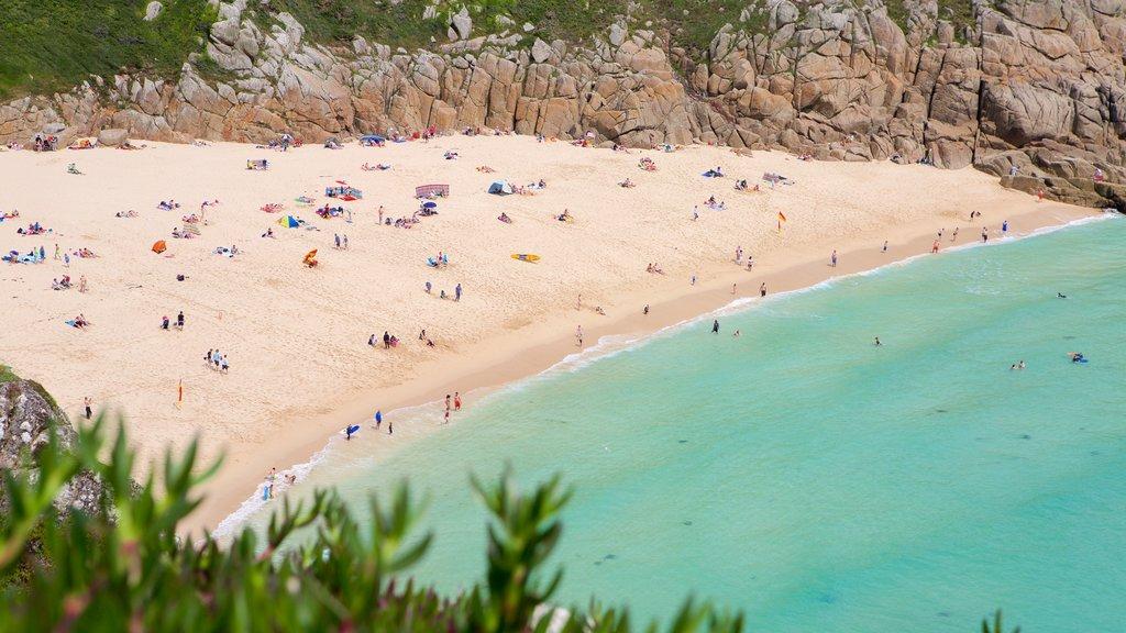 Porthcurno Beach showing rocky coastline and a beach