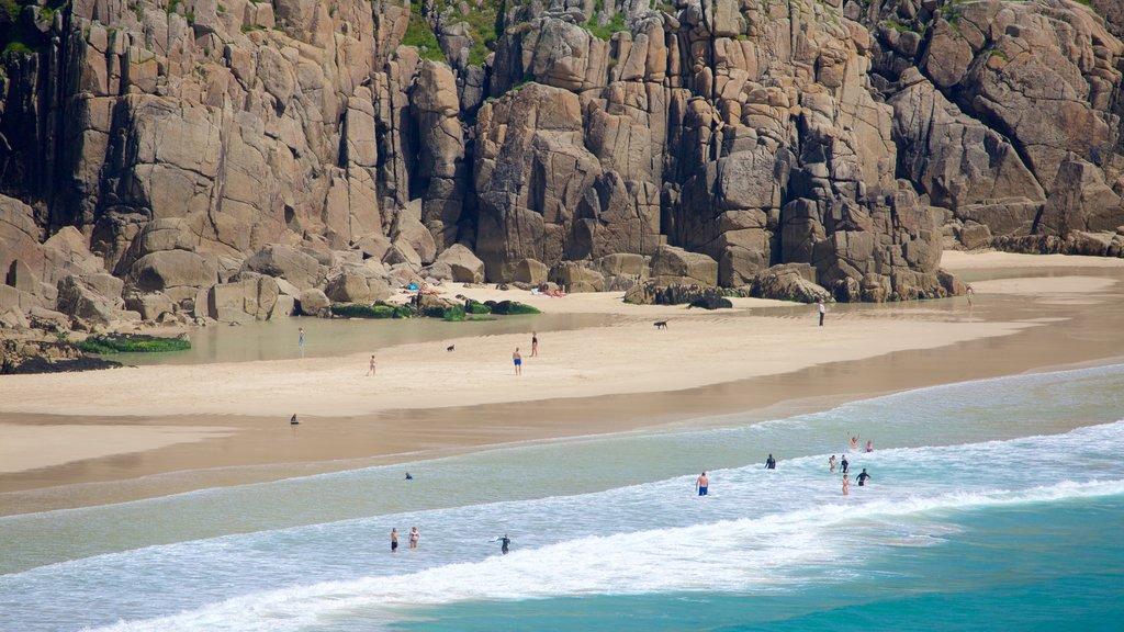 Porthcurno Beach which includes rocky coastline and a beach