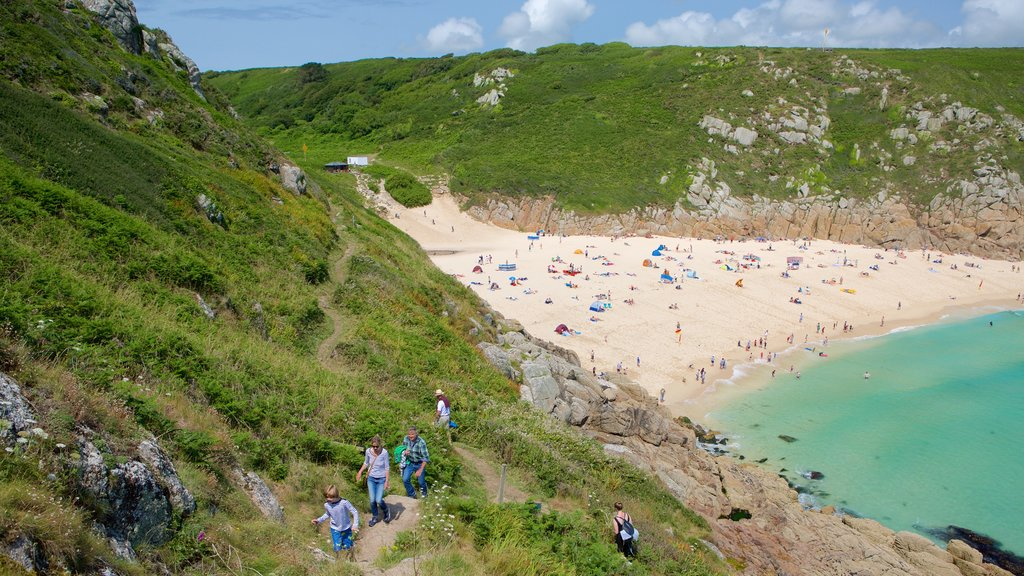 Porthcurno Beach which includes a sandy beach, rugged coastline and hiking or walking