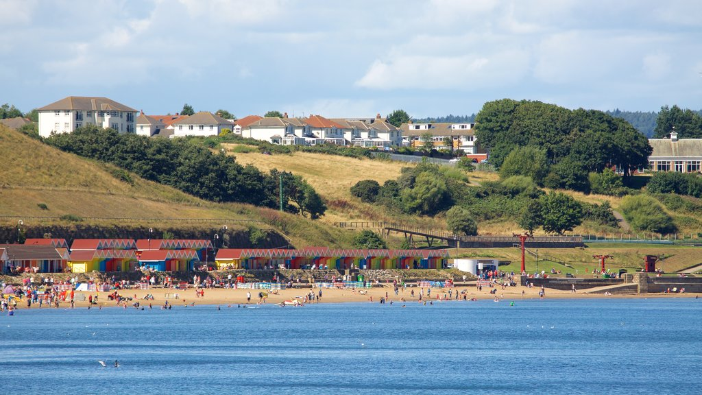 North Bay Beach showing a sandy beach and a coastal town as well as a large group of people