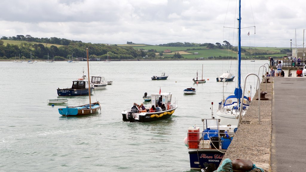 Devon featuring a small town or village, boating and general coastal views