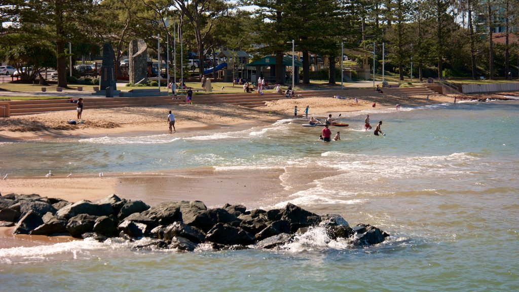 Redcliffe featuring a beach and surf as well as a small group of people