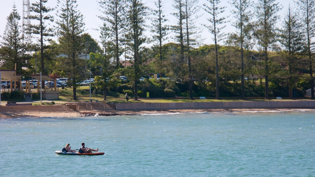 Redcliffe featuring kayaking or canoeing and a beach as well as a small group of people