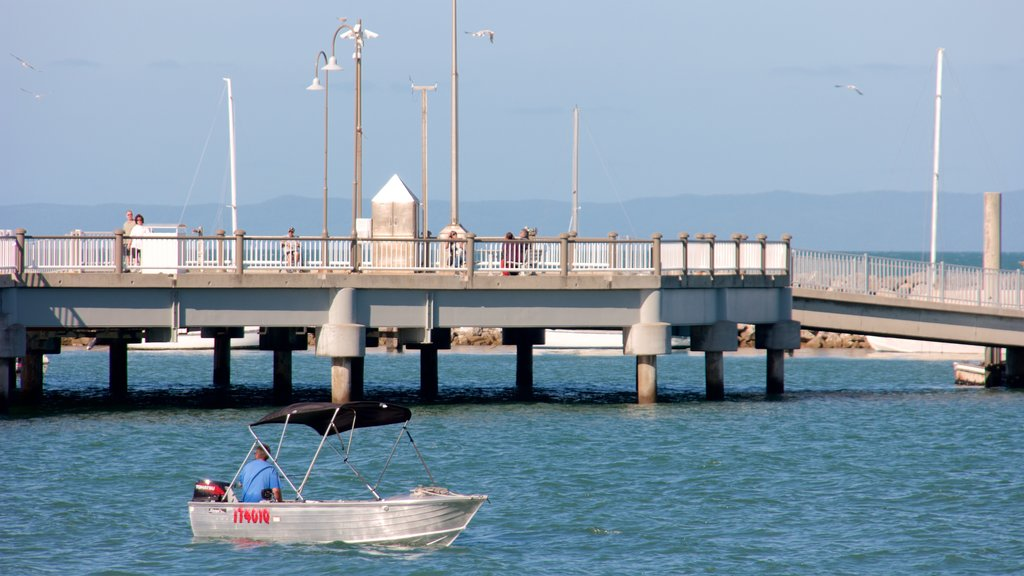 Redcliffe featuring boating and general coastal views as well as a small group of people