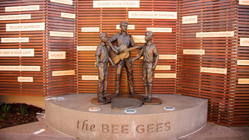 Bee Gees Way which includes a statue or sculpture and outdoor art