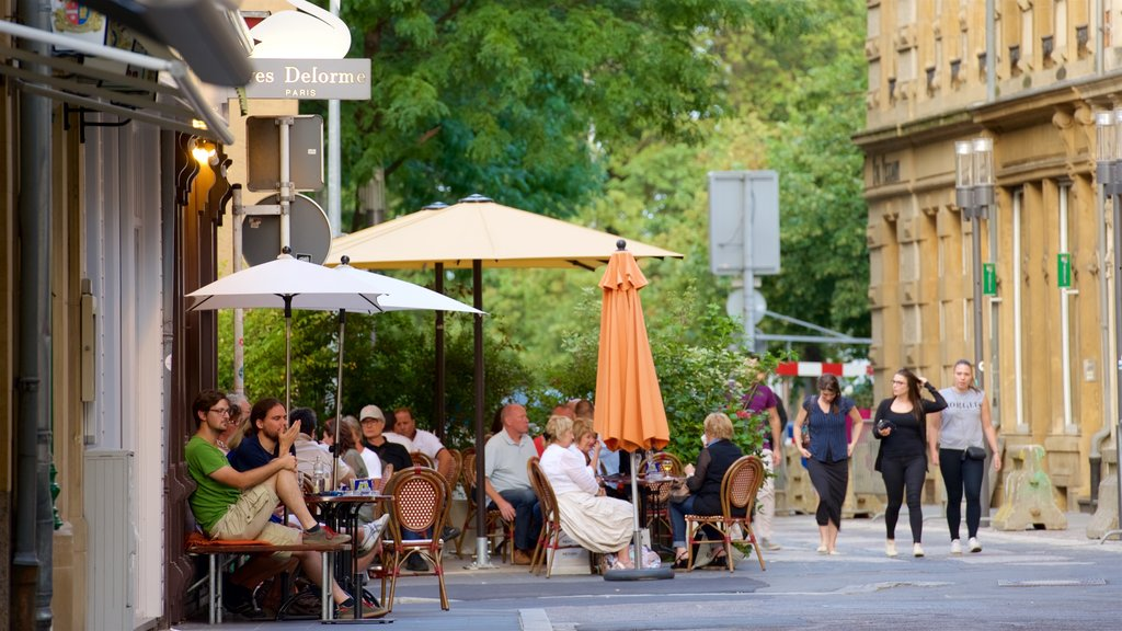 Luxembourg showing cafe scenes and outdoor eating as well as a small group of people