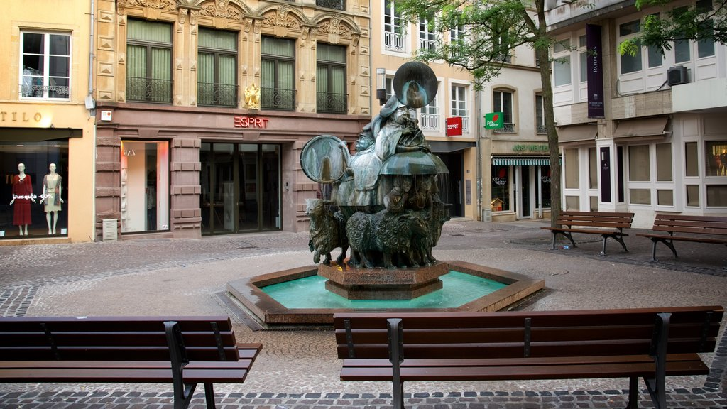 Luxembourg showing a square or plaza and a fountain