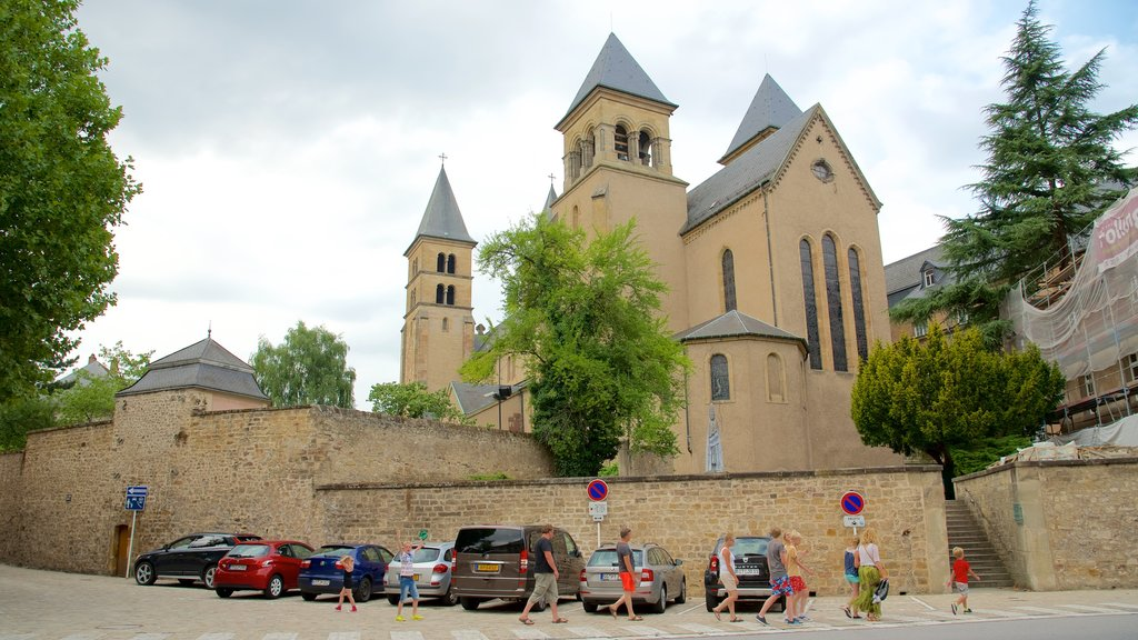 Echternach which includes a church or cathedral and heritage architecture as well as a small group of people
