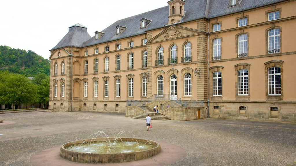 Echternach showing heritage architecture, a fountain and a castle