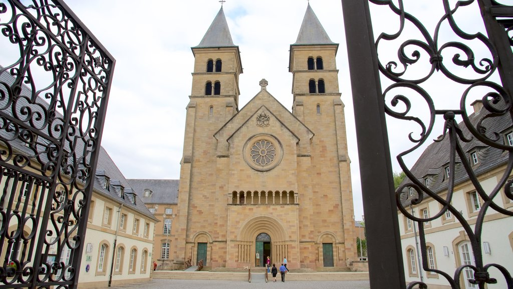 Echternach featuring a church or cathedral as well as a small group of people