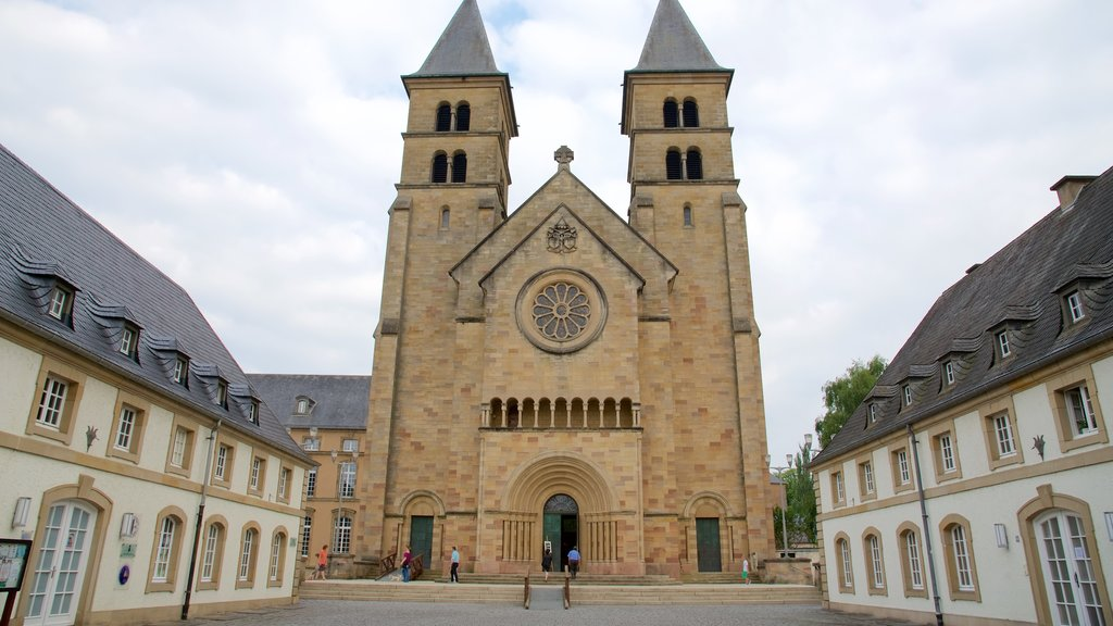 Echternach which includes a church or cathedral as well as a small group of people