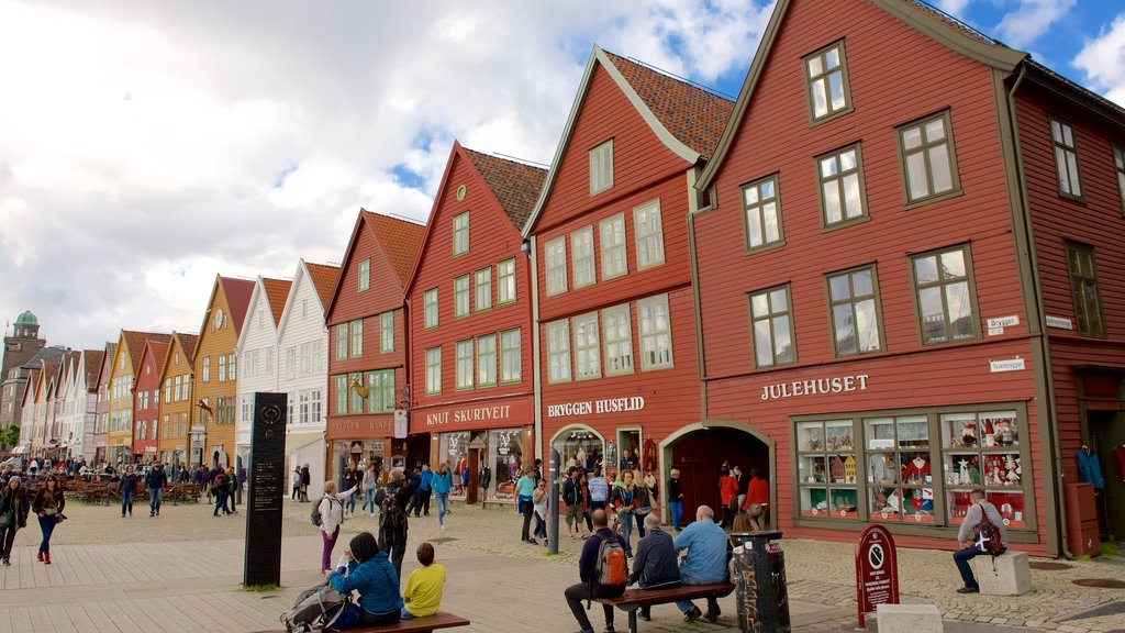 Bryggen featuring shopping and a small town or village as well as a large group of people