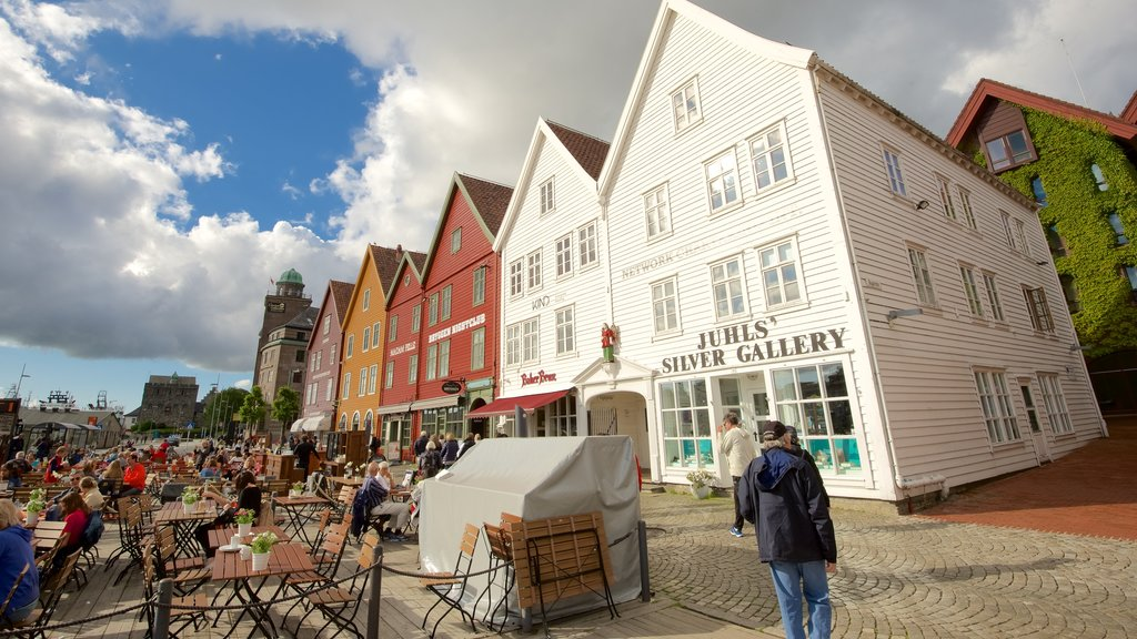 Bryggen showing outdoor eating and a small town or village as well as a large group of people