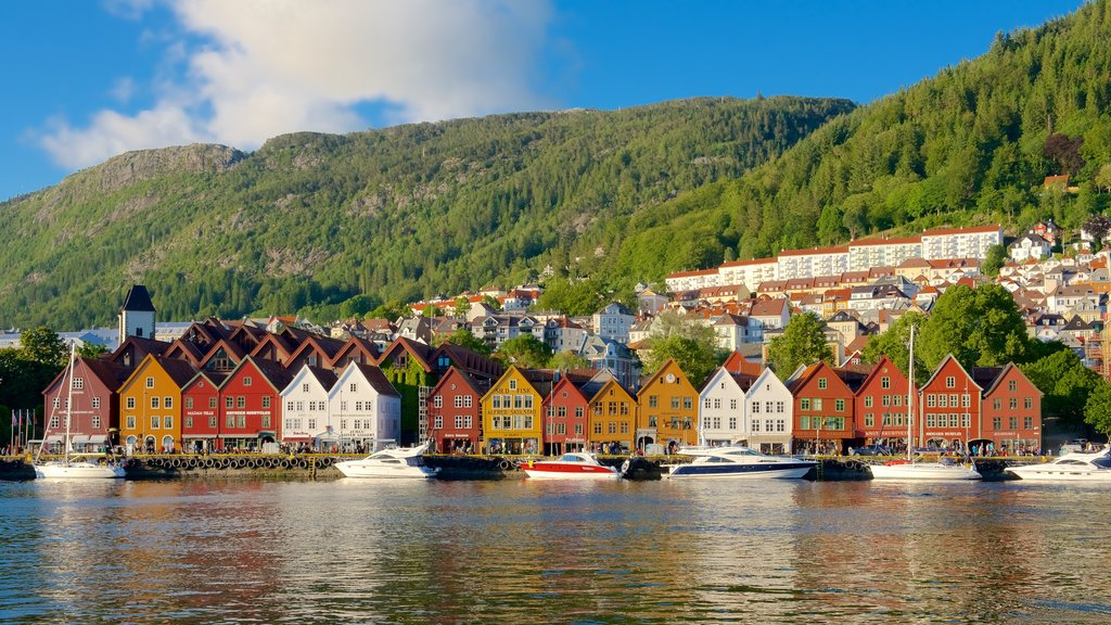 Bryggen which includes general coastal views, a small town or village and boating