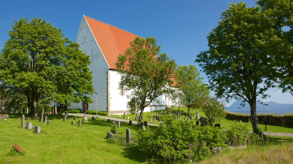 Trondenes Church featuring a church or cathedral and a cemetery