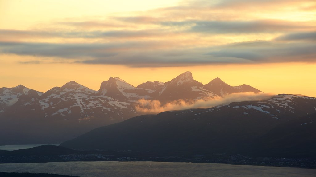 Tromso featuring mountains and a sunset