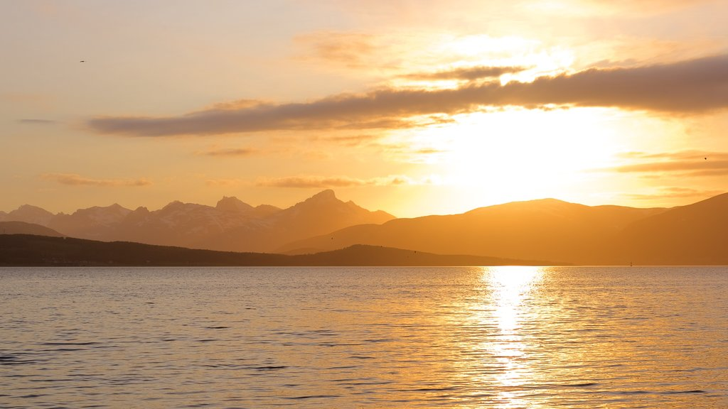 Tromso which includes a sunset, a lake or waterhole and landscape views