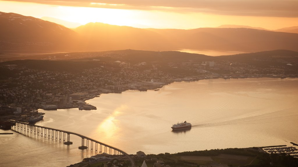 Tromso showing boating, a small town or village and a sunset