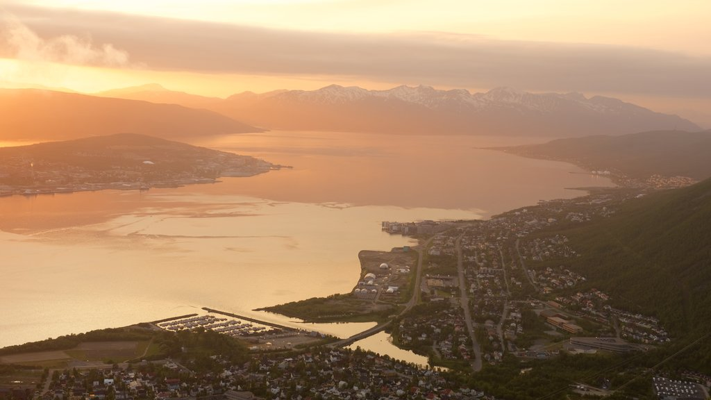 Tromso showing a sunset, mountains and a lake or waterhole