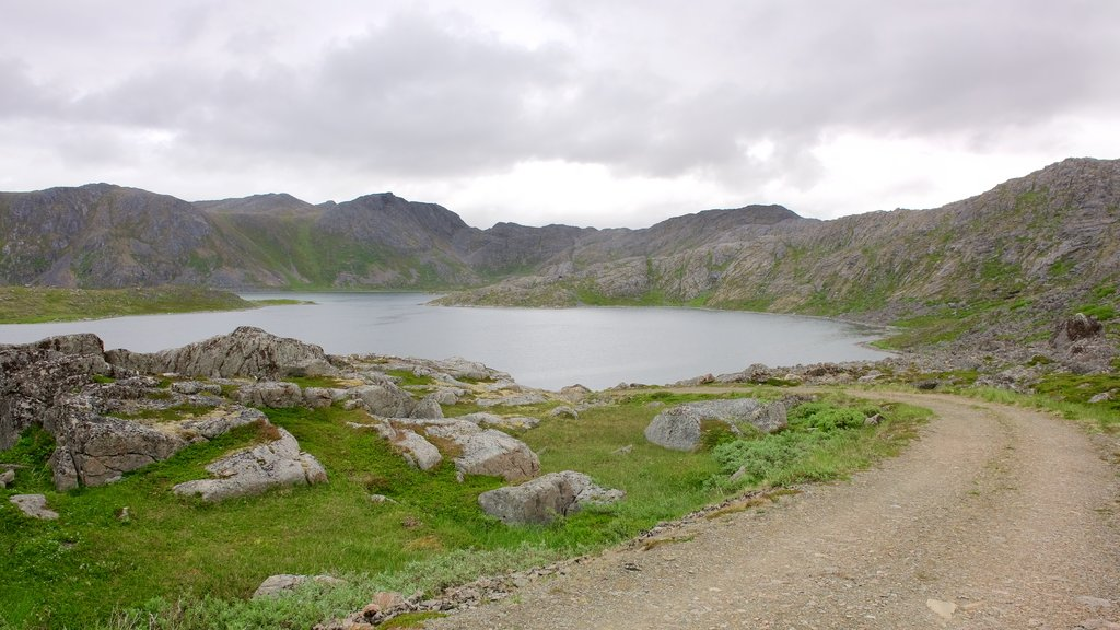 Nordkapp which includes mountains and a lake or waterhole