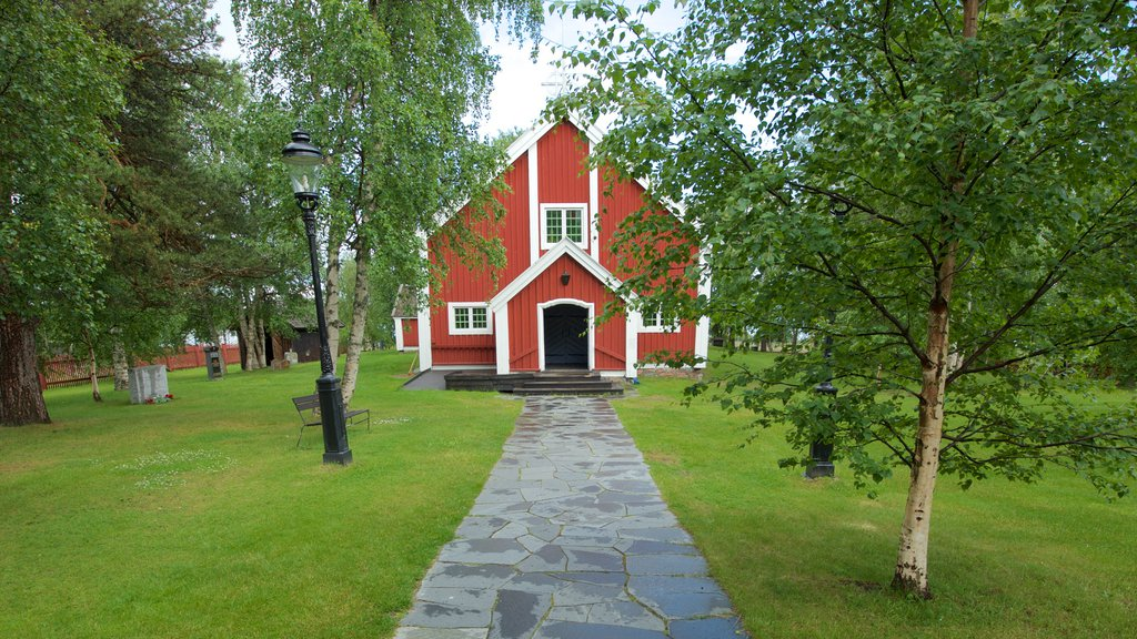 Jukkasjarvi showing heritage architecture, religious elements and a church or cathedral