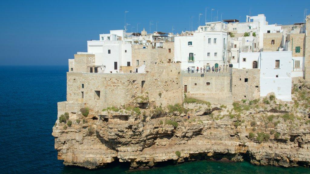 Polignano a Mare featuring rocky coastline and a coastal town