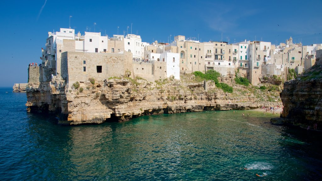 Polignano a Mare which includes a coastal town and rugged coastline