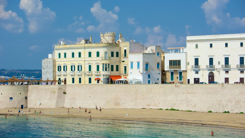 Lecce showing a coastal town, general coastal views and a beach