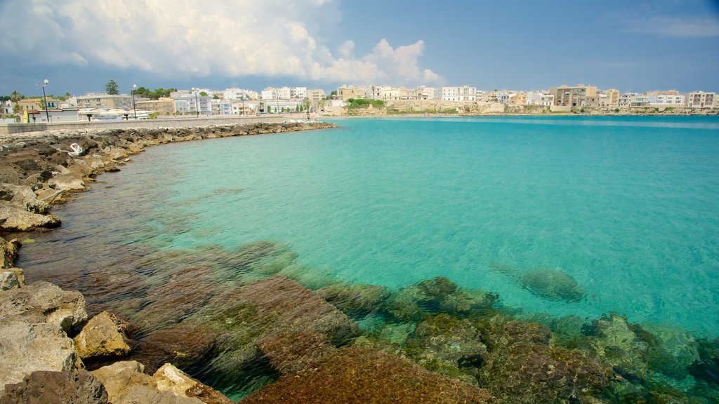 Otranto Waterfront which includes a coastal town and rocky coastline