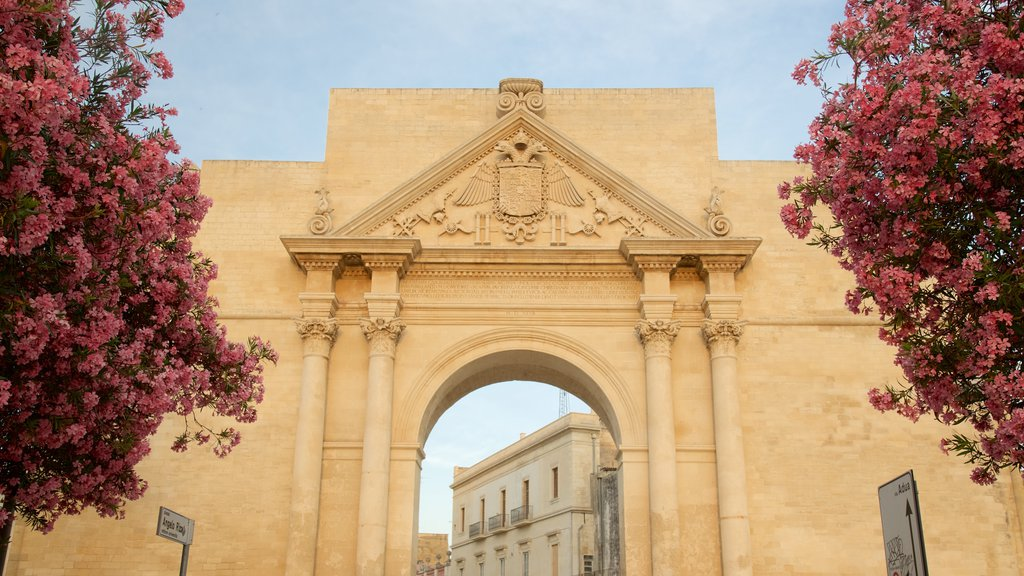 Arco di Trionfo which includes a sunset, heritage architecture and flowers