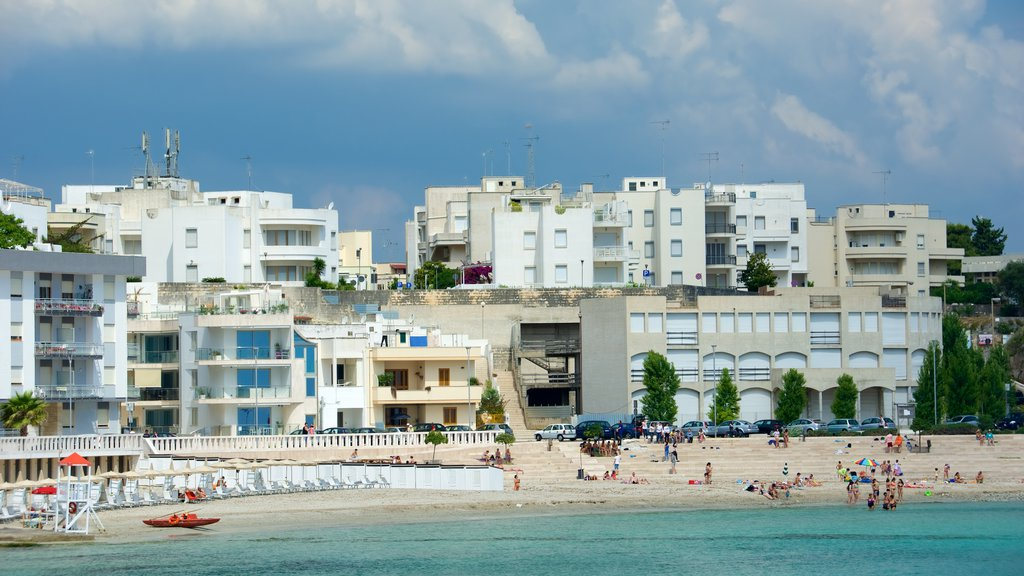Otranto Waterfront featuring a sandy beach and a coastal town
