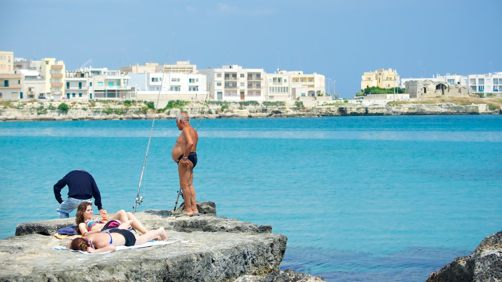 Otranto Waterfront featuring a city and general coastal views as well as a small group of people