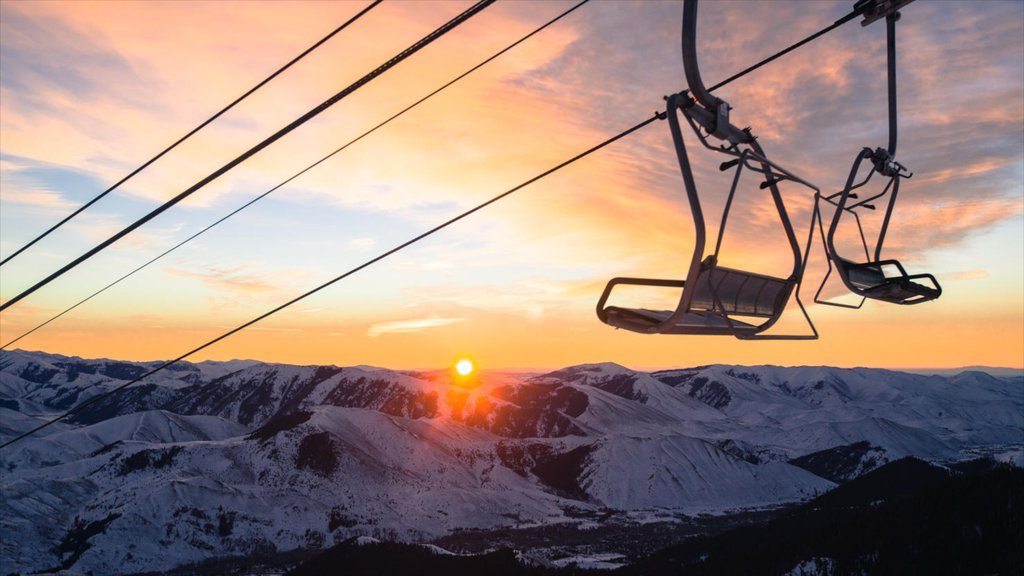 Sun Valley Ski Resort showing a gondola, snow and a sunset