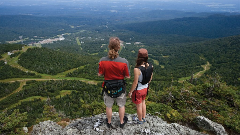 Jay Peak Ski Resort featuring landscape views and hiking or walking as well as a couple