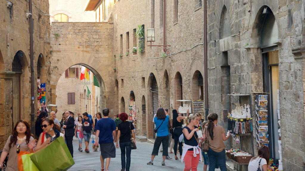 San Gimignano which includes heritage architecture as well as a large group of people