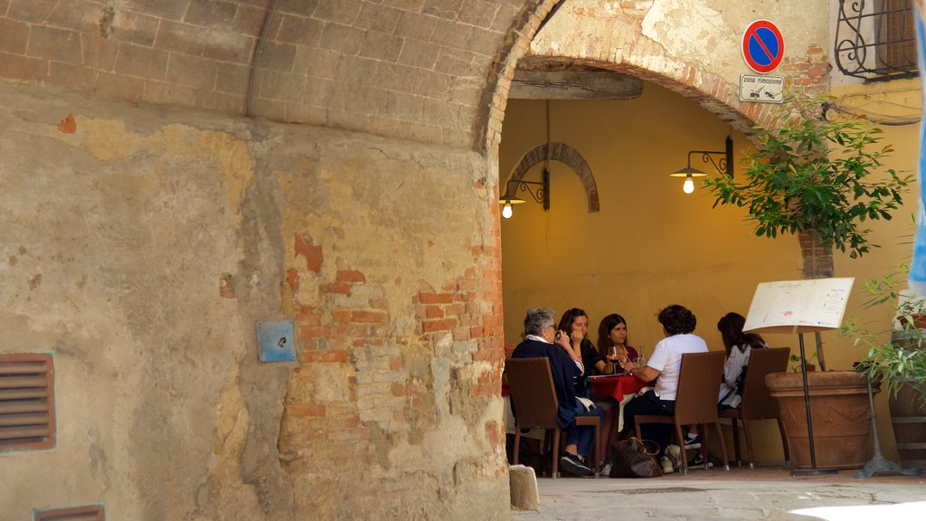 Montepulciano featuring outdoor eating and heritage architecture as well as a small group of people