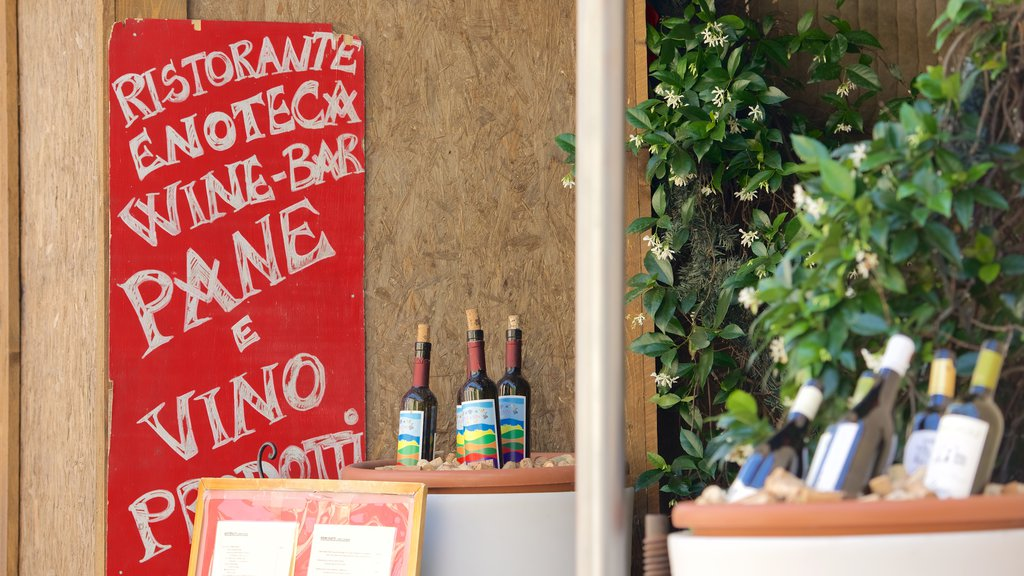 Todi showing drinks or beverages and signage