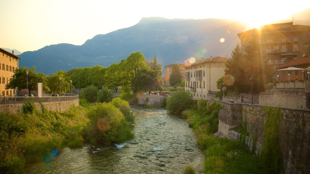 Rovereto showing a river or creek and a sunset