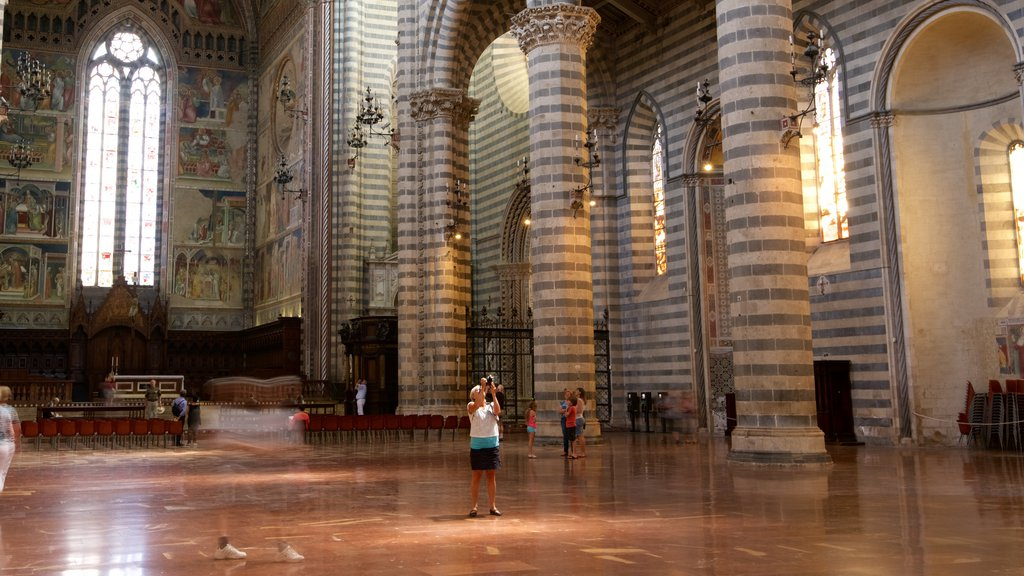 Duomo di Orvieto featuring heritage architecture, interior views and religious elements