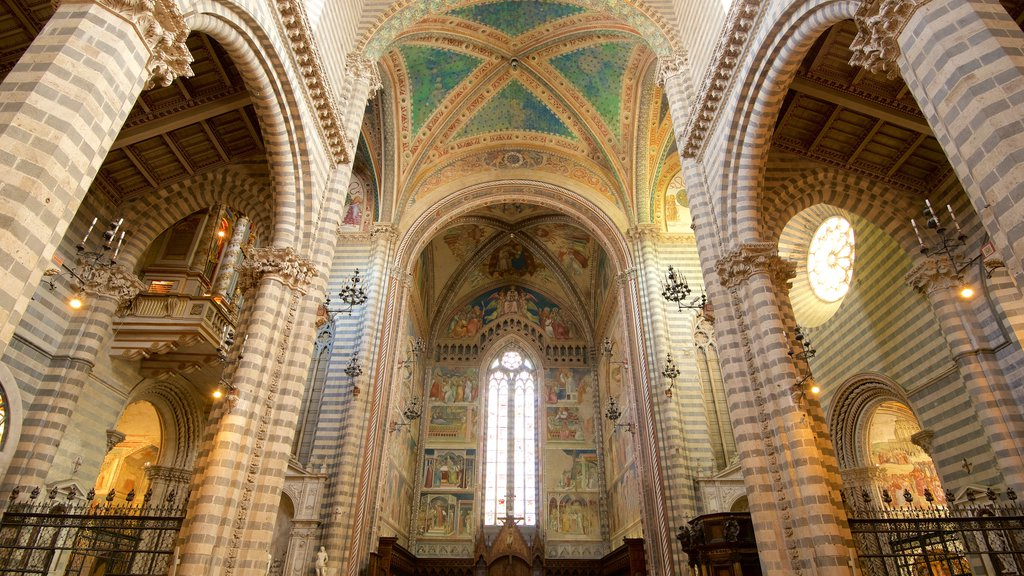Duomo di Orvieto which includes a church or cathedral, religious aspects and interior views