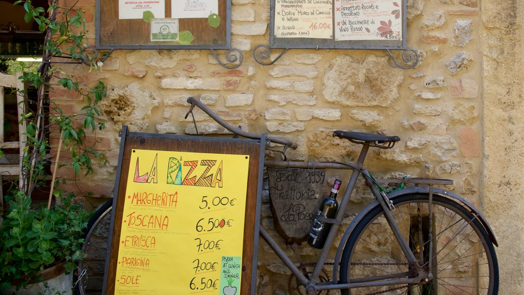 Volterra which includes cafe scenes and signage