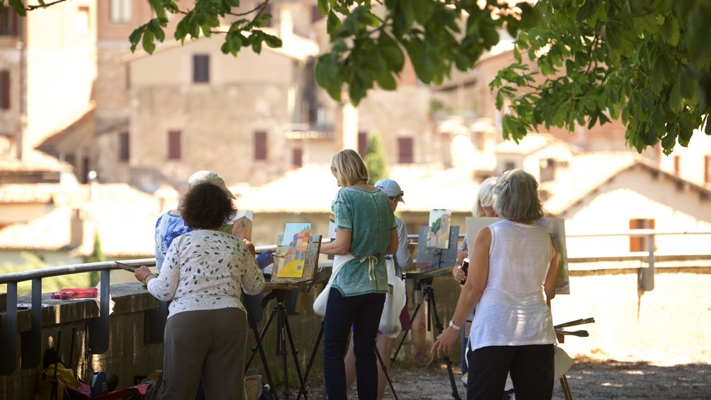 Todi which includes art and outdoor art as well as a small group of people