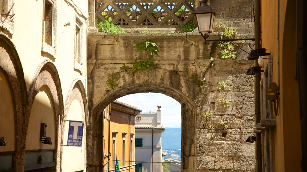Porta Marzia which includes a small town or village and heritage architecture