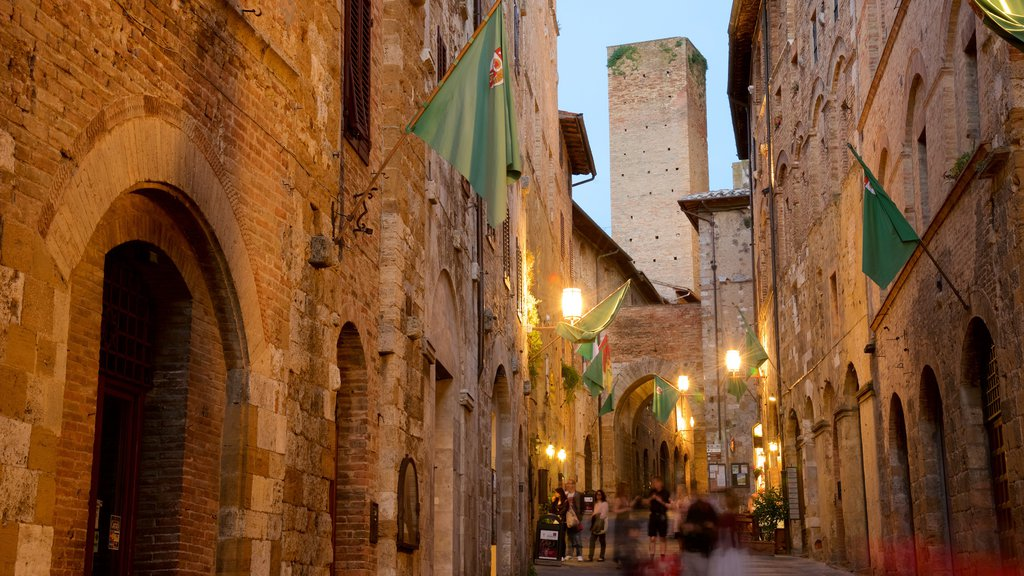 San Gimignano featuring night scenes, street scenes and heritage architecture